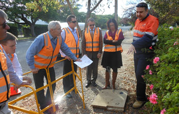Committee members inspecting pits and pipes with NBN Co, Willunga S.A.
