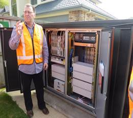 A Chorus representative showing the cabinet infrastructure supporting the copper and fibre networks